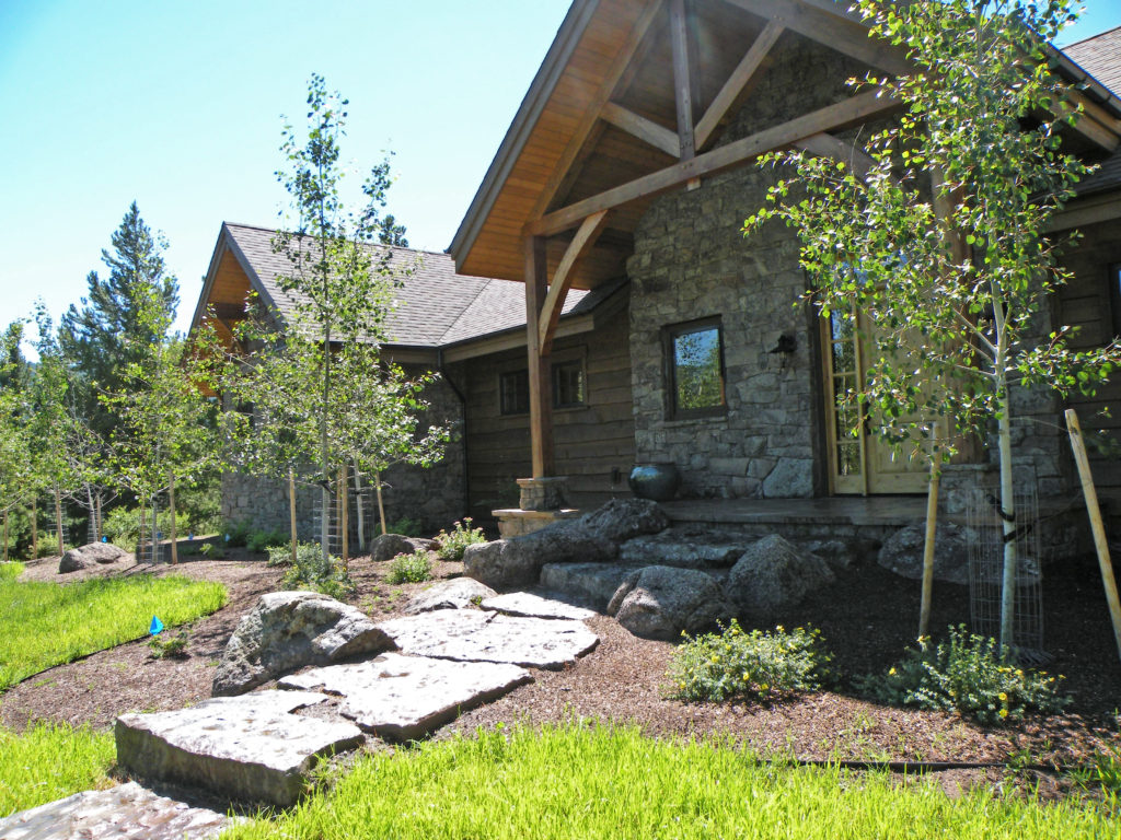 Moss rock slabs and boulders create a natural path to this Bridger Canyon home.